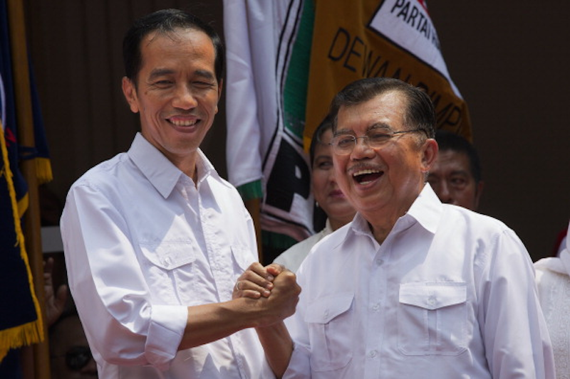Indonesian Presidential frontrunner Joko 'Jokowi' Widodo and his Vice Presidential running mate Jusuf Kalla announce their ticket on 19 May. Image: GETTY